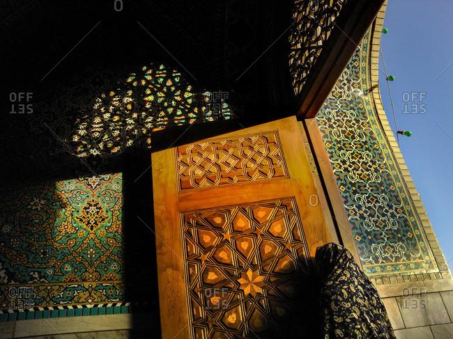 Muslim woman during prayer in holy mosque of Imam Reza, Mashad, Iran