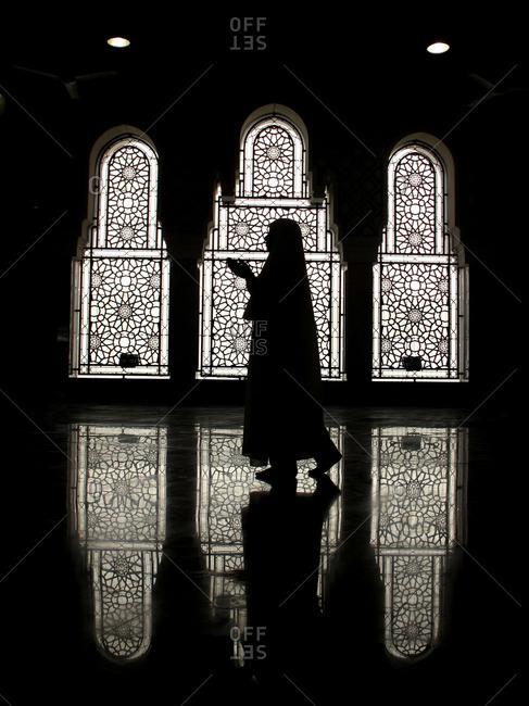 Mecca, Saudi Arabia - April 28, 2009: Muslim woman praying in Kaaba Mecca