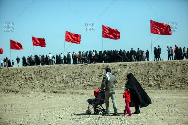 Family visiting a former battlefield of the Iran-Iraq war near border, Ahwaz, Iran