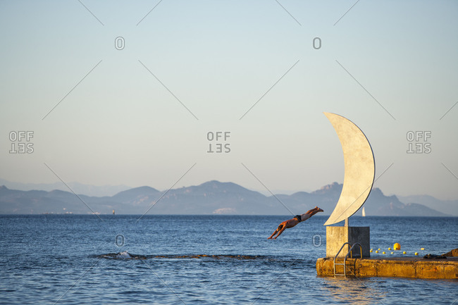 Swimmer and Moon Statue, St. Tropez, Var, Cote d'Azur, French Riviera, Provence, France