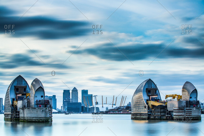 London, England, United Kingdom - February 16, 2013: Thames Barrier on River Thames and Canary Wharf in the background, London, England, United Kingdom