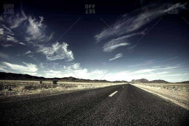 Long empty desert road in Morocco