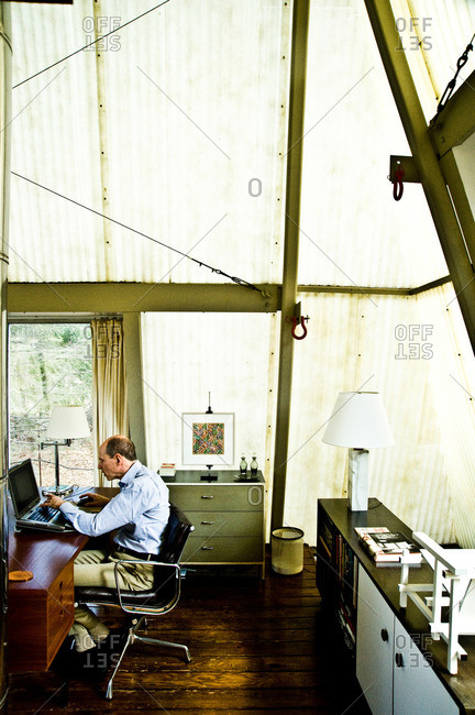 Halas Lane, Stanfordville, NY - USA - April 3, 2013: Man typing on a laptop in his home office