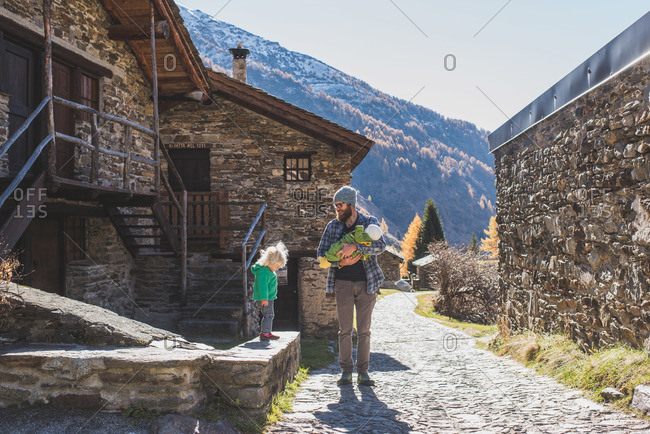 Father and children in an old mountain village