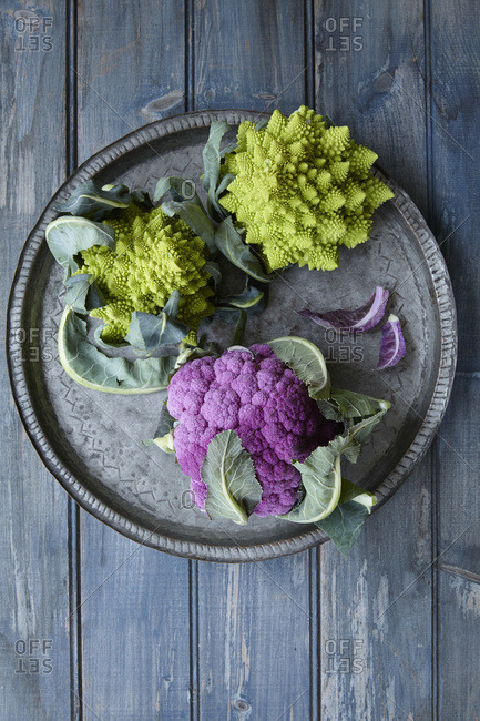 Heads of Romanesco broccoli and purple cauliflower