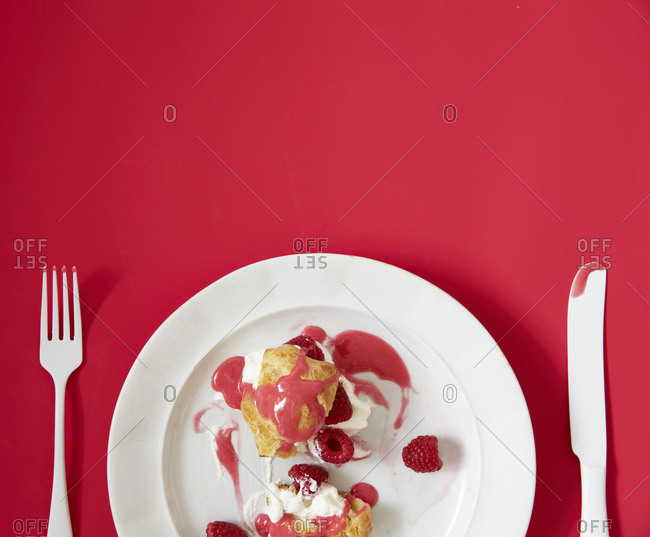 Raspberry eclairs on a plate