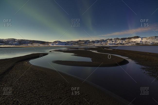 Aurora Borealis over Icelandic landscape