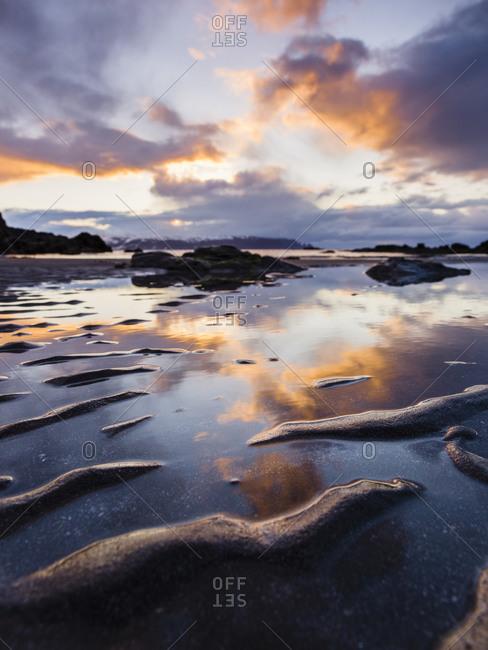 Sky reflected on still Icelandic water