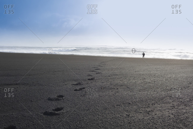 Footprints on beach in Iceland