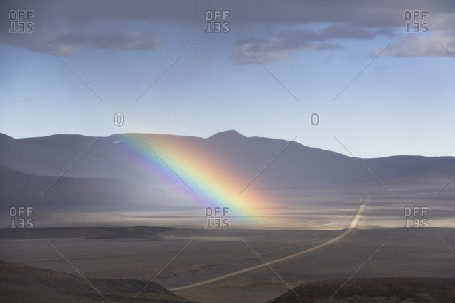 Rainbow over mountain plain in Iceland
