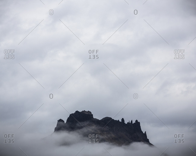 Jagged peak in the clouds, Iceland