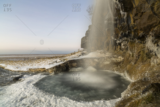 Cascade in wintery rural Iceland