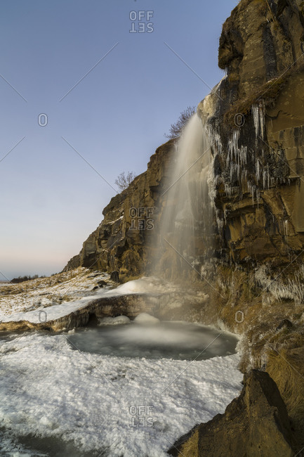 Cascade in icy rural Iceland