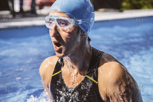 Female triathlete taking a deep breath while swimming