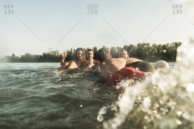 Happy friends in water