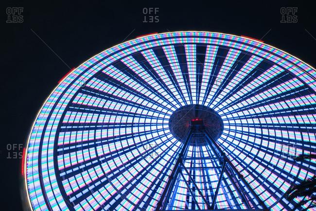 Osaka, Japan - September 14, 2015: Tempozan Ferris Wheel spinning at night in Osaka, Japan