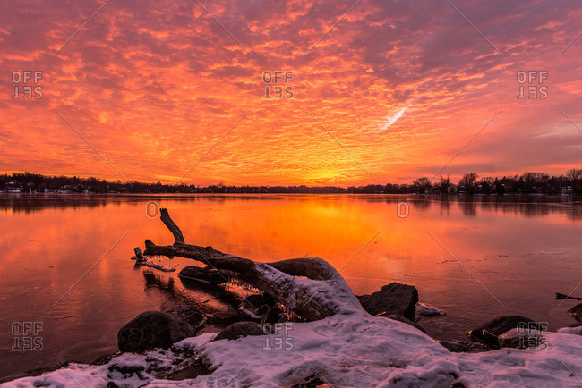 Sunset over a lake during winter in Ontario, Canada
