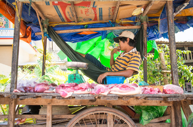 Duong Dong, Vietnam - April 20, 2015: Street vendor taking a cigarette break in Vietnam