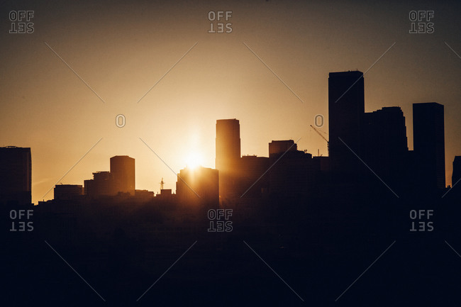 City skyline silhouetted at dusk