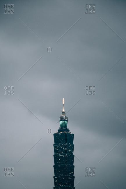 Taipei 101 Tower against overcast gray sky