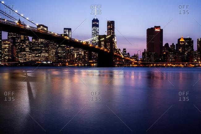 New York City and the Brooklyn Bridge at dusk