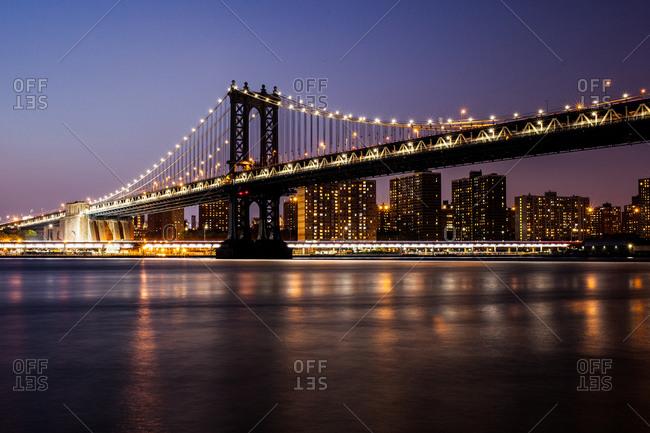 Lights of the Manhattan Bridge at dusk