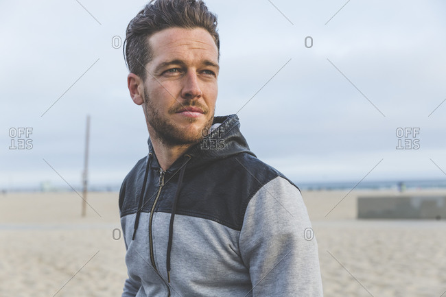 Portrait of man resting after a workout on the beach