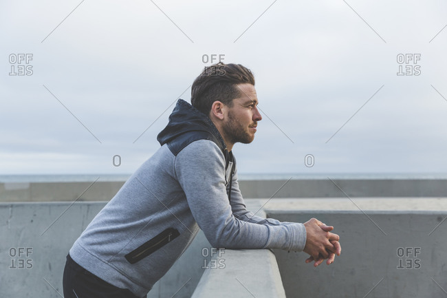 Man resting after a workout by the beach