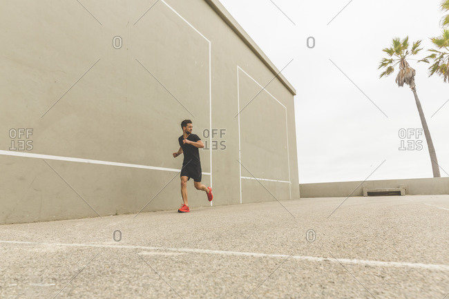Athletic man running during an outdoor workout