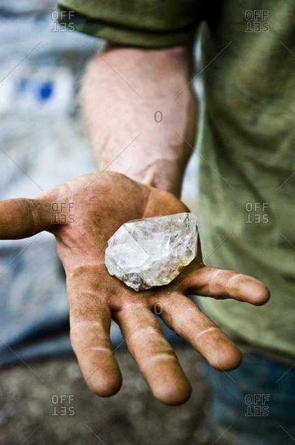 A man showing a Herkimer diamond