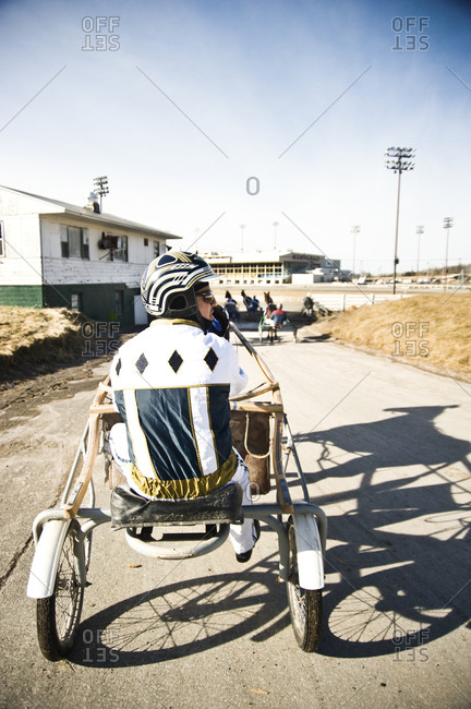 Monticello, New York - January 19, 2012: Harness racer Joe Lee and East Coast girl head out for a warm up run at Monticello Raceway