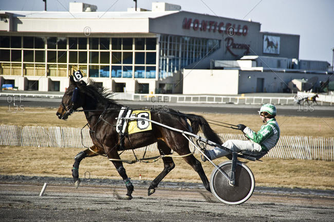Monticello, New York - January 19, 2012: Harness racing warm up before a race at Monticello Raceway