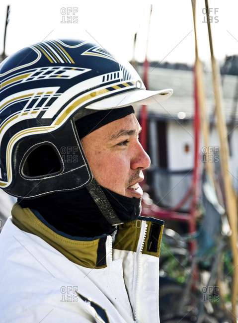 Monticello, New York - January 19, 2012: Harness racing driver Joe Lee waiting to be called for race at Monticello Raceway