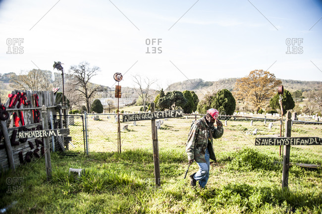 Birmingham, Alabama - April 2, 2013: Artist Joe Minter showing the migration of the dead (black cemetery) through the fence and into his village to speak