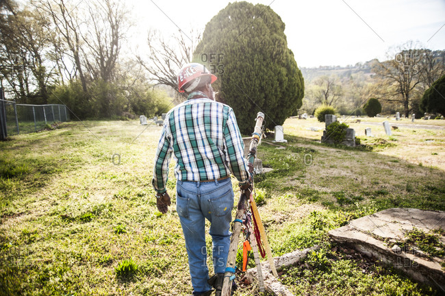 Birmingham, Alabama - April 2, 2013: Artist Joe Minter showing where his father is buried in the black cemetery