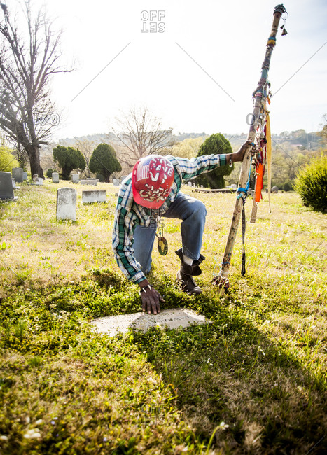 Birmingham, Alabama - April 2, 2013: Artist Joe Minter where his father is buried in the black cemetery