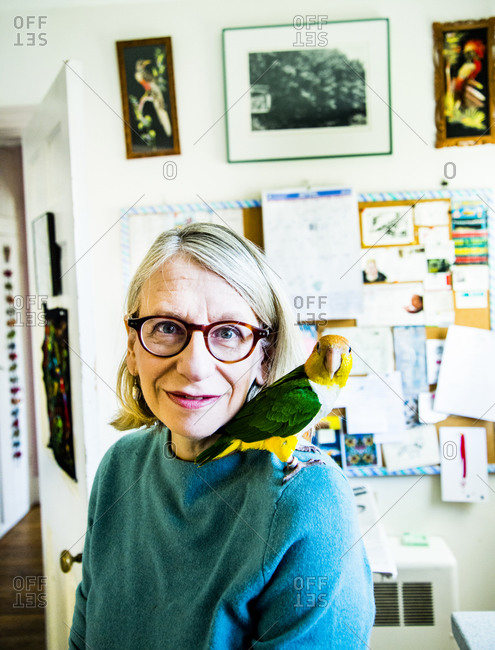 Ridgefield, Connecticut - April 3, 2014: New Yorker Cartoonist Roz Chast at home with one of her parrots