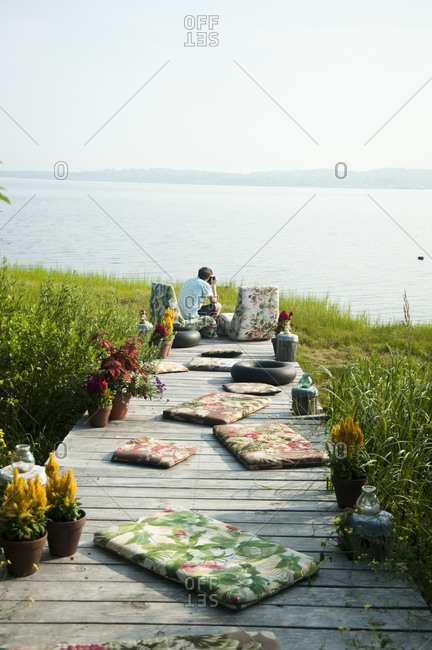 Montauk, New York - July 23, 2011: Sitting on the dock at Chandelier Creative's Surf Shack