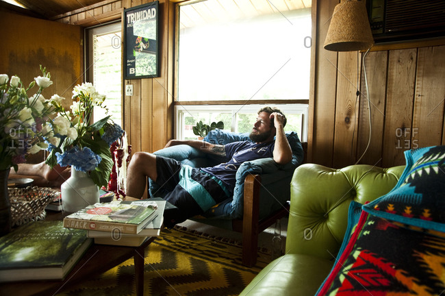 Montauk, New York - July 23, 2011: Relaxing inside the Surf Shack which Chandelier Creative founder Richard Christiansen created for employees