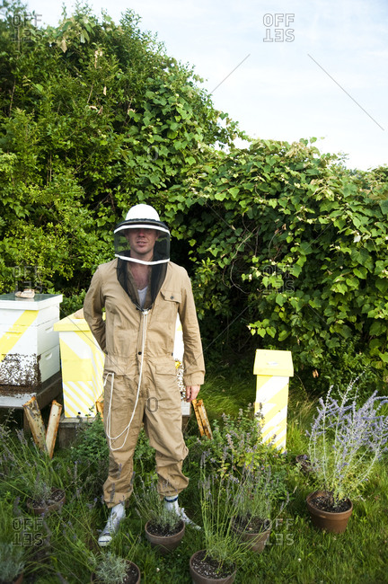 Montauk, New York - July 23, 2011: Chandelier Creative founder Richard Christiansen tending to his bees at Surf Shack