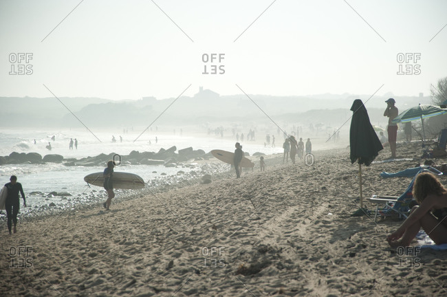 Montauk, New York - July 22, 2011: Beachgoers and surfers
