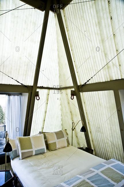 Stanfordville, New York -  April 3, 2011: Bed inside Plastic Tent House designed by John M. Johansen