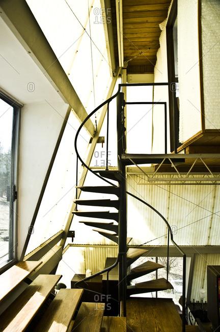 Stanfordville, New York -  April 3, 2011: Spiral staircase in Plastic Tent House designed by John M. Johansen