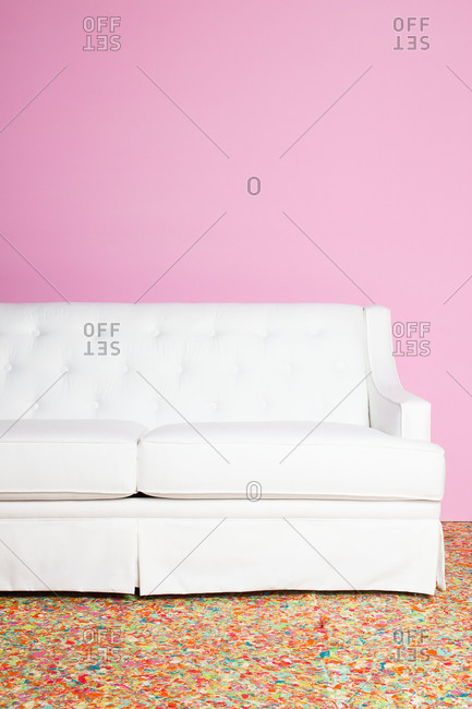 White couch in a pink room