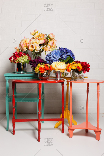 Still life of flower bouquets on colorful tables