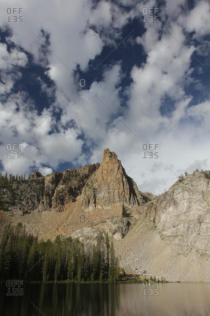 Sharp mountain peak above lake