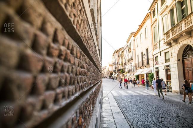 Street scene along brick wall in historic Italian village