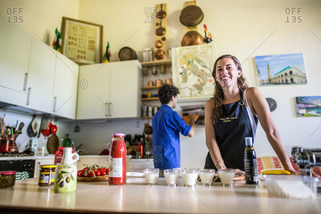 Riva del Garda, Italy - July 11, 2015: Young woman taking an Italian cooking class in Venice, Italy