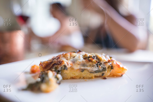 Close-up of slice of hot pizza on plate