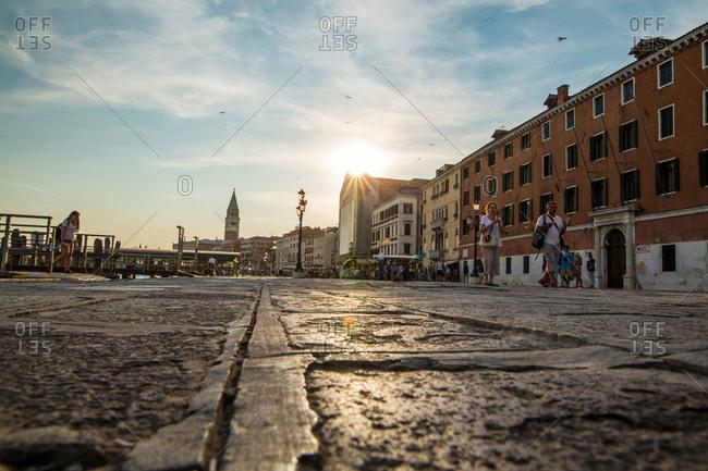 Riva del Garda, Italy - July 11, 2015: Waterfront city street in Italy at sunset